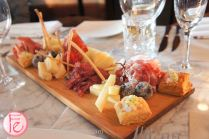 Italian Tagliere: Selection of imported Italian D.O.P. cold cuts and cheese with breaded olive taggiache, arancini and parmigianina crostino