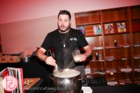 chef cooking clam chowder at hush hush party 2014