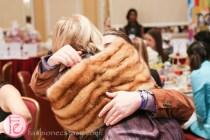 robin kay hugs david dankly at tea and tiaras starlight children's foundation