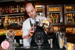 peter pan bistro mixologist mixing martini