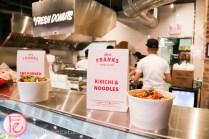 fancy franks gourmet hot dog kimchi and noodles