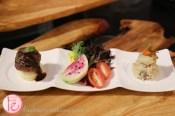 trio tapas micro green salad, wild mushroom risotto, petite striploin with Foie jus by Encore Catering