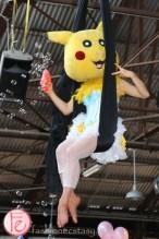 acrobatic performers on trapezes in pokemon costume