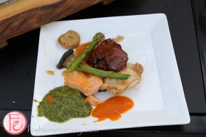 plate of grilled salmon, steak and asparagus by food dudes