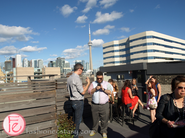 the burroughes building rooftop with cn tower backdrop