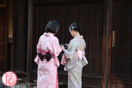 tourists in kimono hanami-koji, gion area in kyoto
