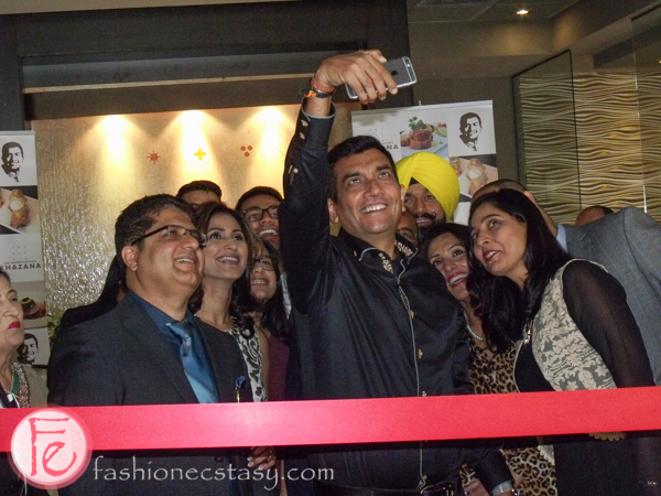 Sanjeev Kapoor takes a selfie before Khazana Restaurant ribbon-cutting