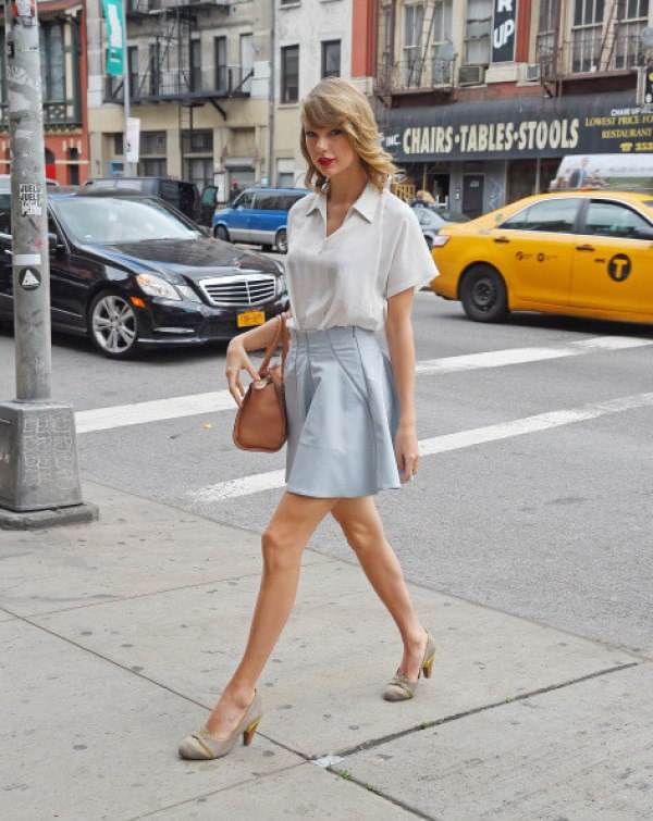 Taylor Swift in Blue skirt with white top