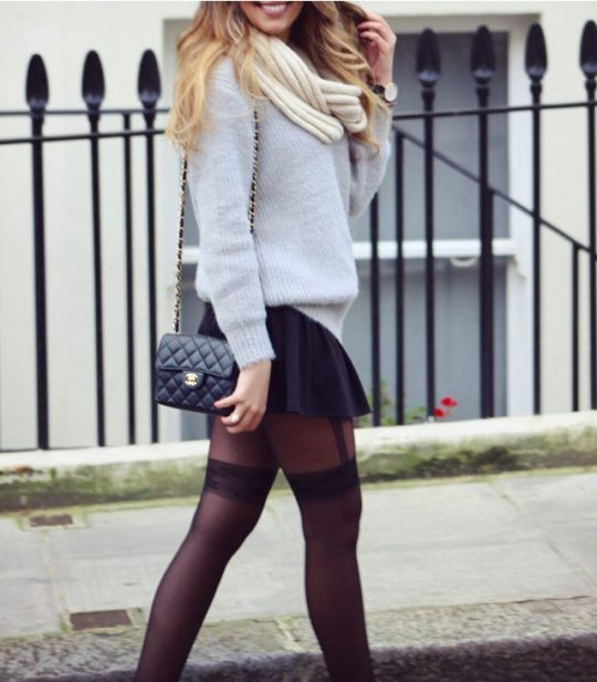 Cute winter outfit with sexy tights and oversized sweater