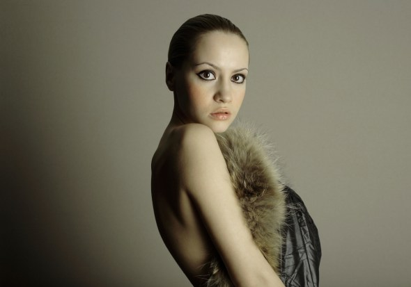 young elegant fashion model staring into camera