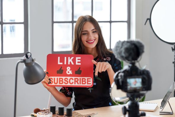 Social media influencer asking followers to like and subscribe