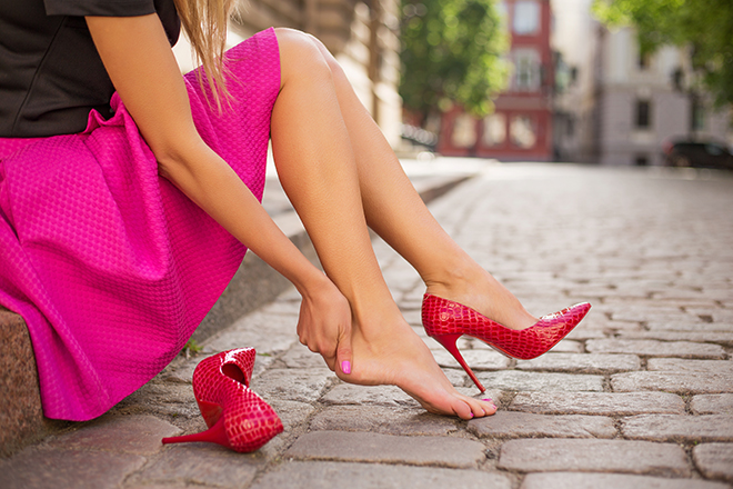 How-to-Choose-the-Right-Heel-Height-for-You-woman-in-pink-shoes-rubbing-heel