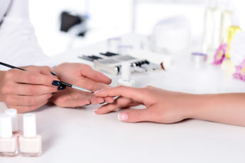 how-to-choose-the-best-nail-salon-woman-getting-a-manicure