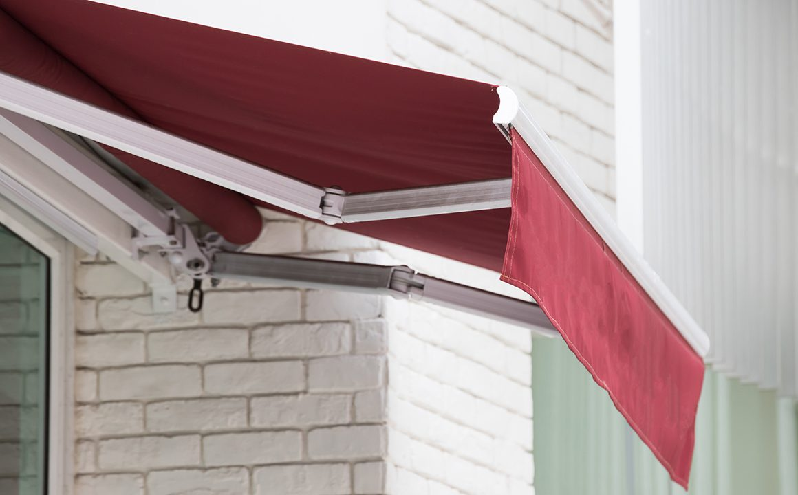 red awning over window of shop.