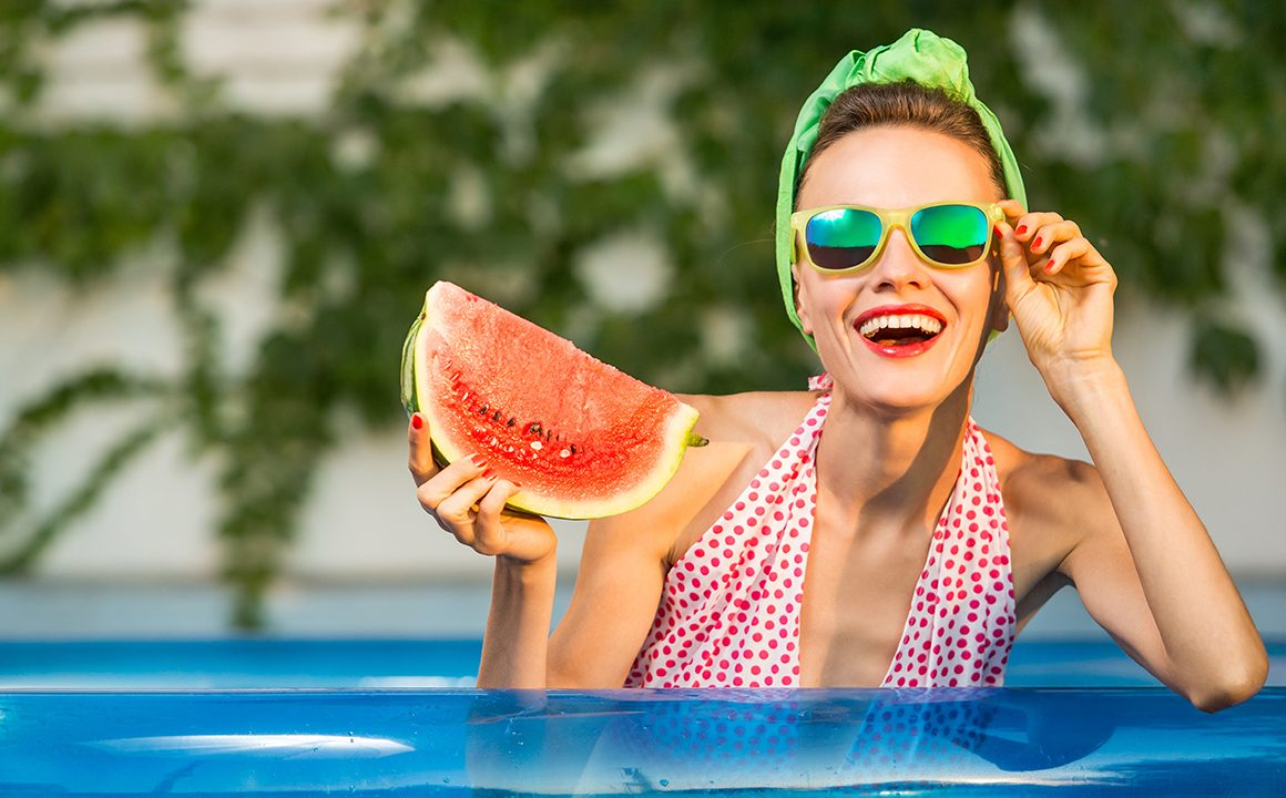 guide-to-ethical-and-eco-friendly-eyewaer-girl-in-pool-during-summer-in-glasses-holding-watermelon