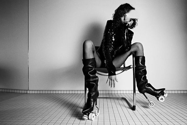 Saint Laurent Ad with woman sitting on a chair