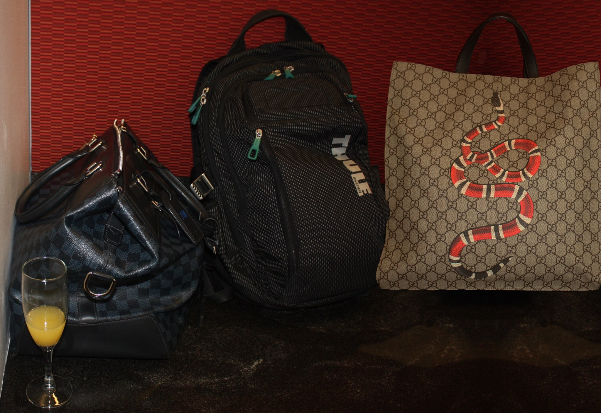 Speakers' tote bags, including a Gucci bag with a snake