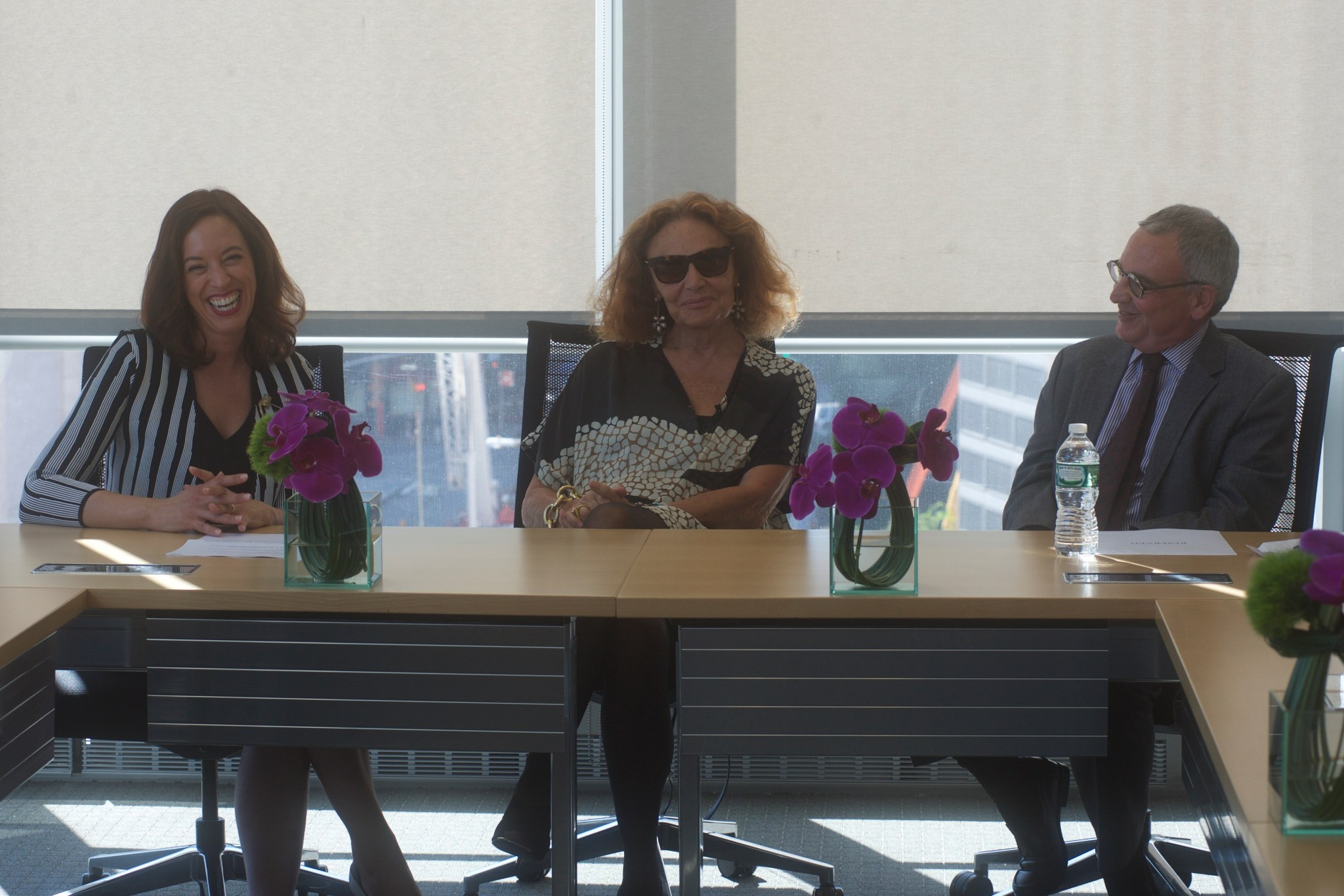 Professor Scafidi, CFDA Chair Diane von Furstenberg, and Provost Stephen Freedman seated at the announcement of the world's first master's degrees in Fashion Law