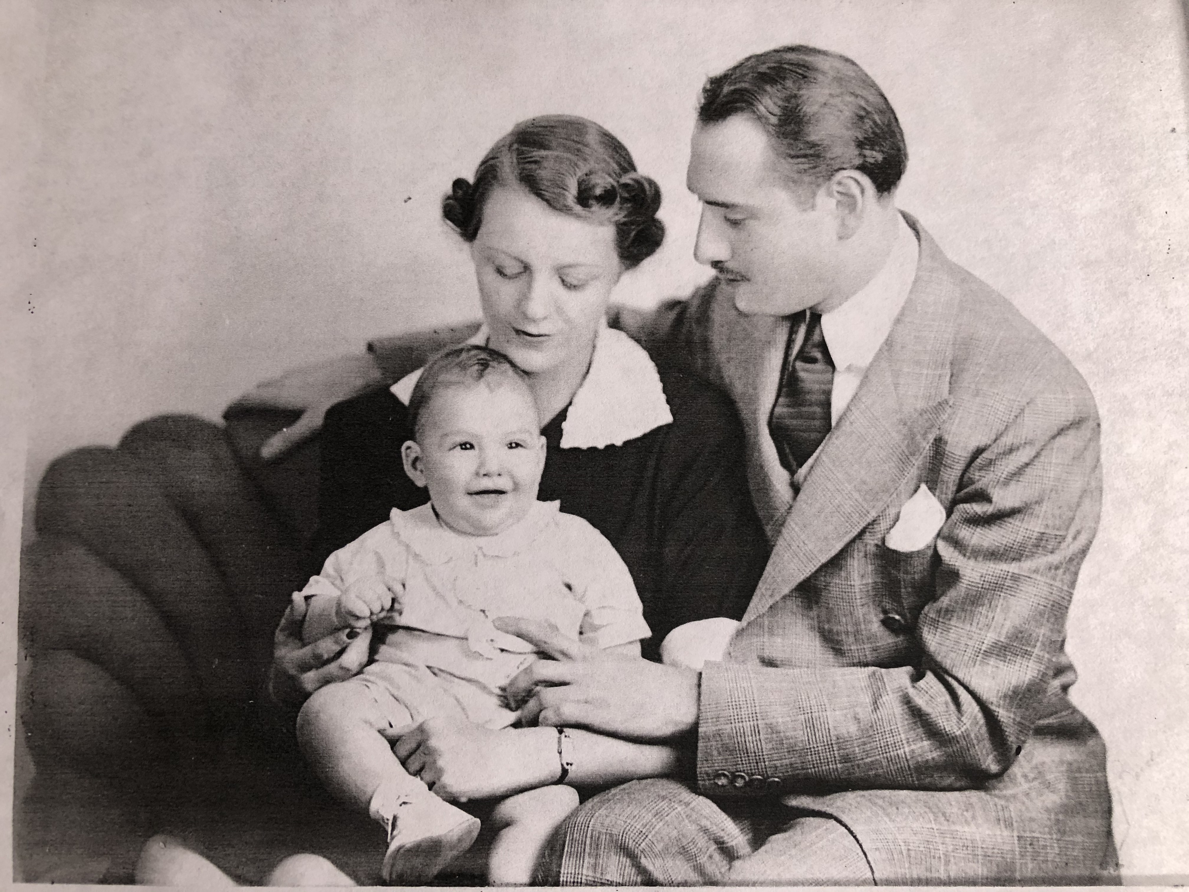 Arnauld as an infant, held by his parents, Catherine and Antone Scafidi