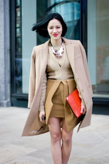 street-style-bright-clutch-bags-bright-orange-clutch-chunky-statement-necklace-wrap-skirt-neutral-jacket-look-tiffany-hsu-vogue-uk-1