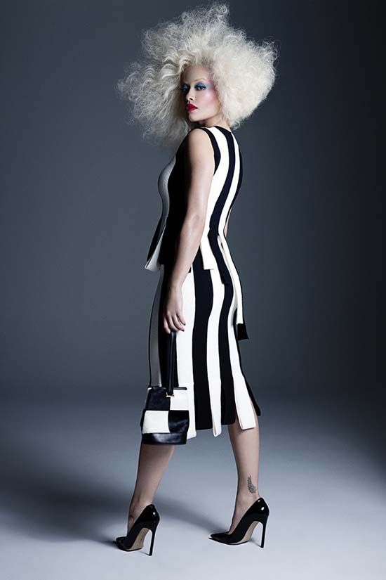 Rita Ora in Salvatore Ferragamo top, skirt and bag with Manolo Blahnik pumps.