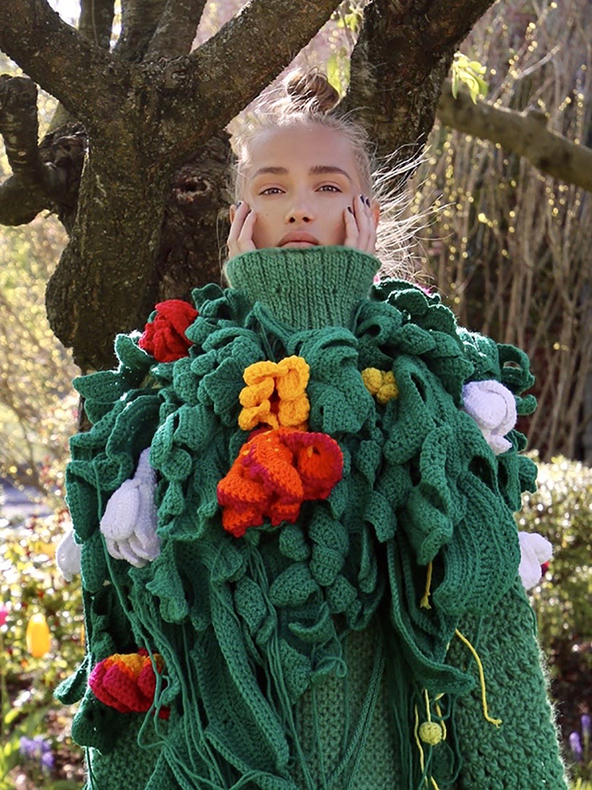 Shades of green oversized hand knit dress embelished w/brightly colored crochet botanical elements