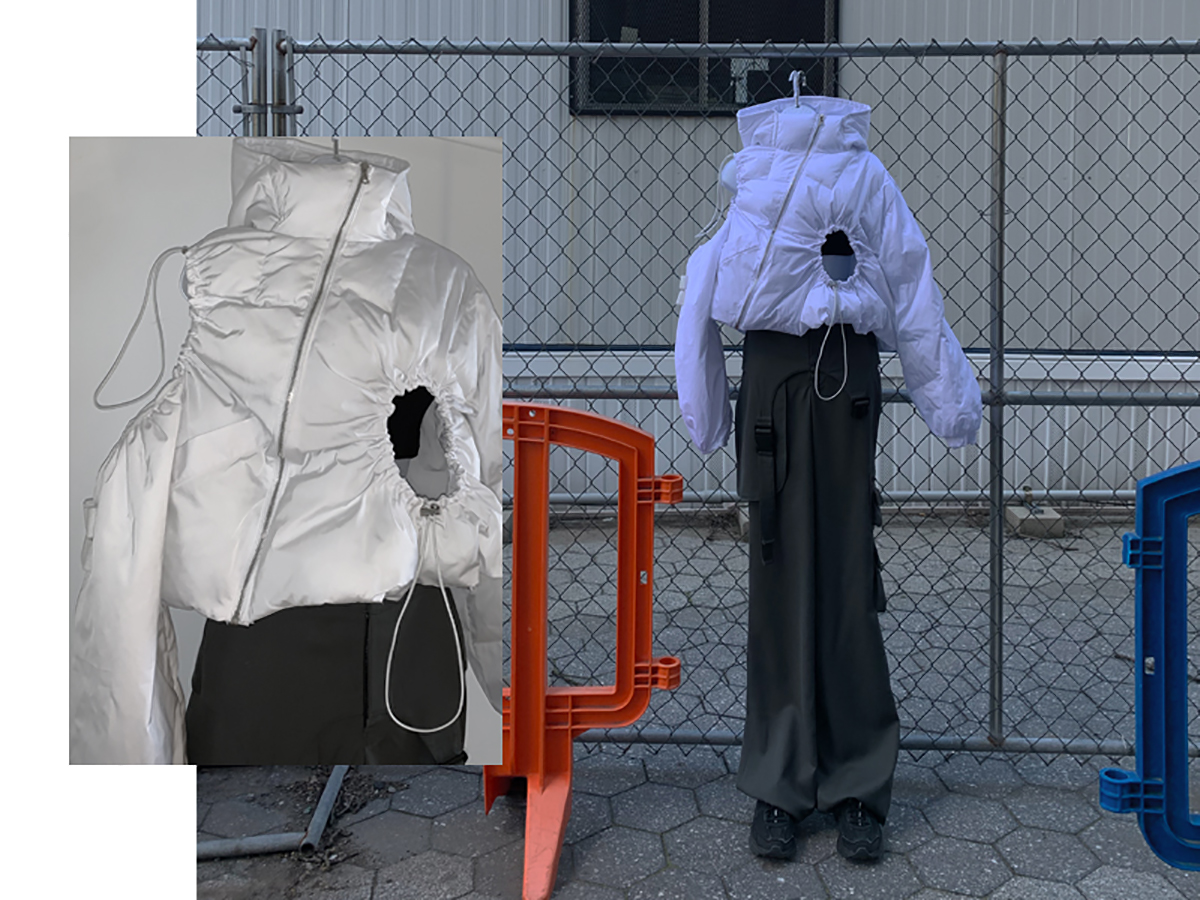 """White nylon asymmetrical puffer jacket with drawstring """"openings"""" and charcoal """"harnessed"""" utility trouser"""