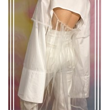 Details of pleated organza, back cutout and high waisted denim pant with tri-color topstitching