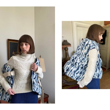 Quilted jacquard knit vest over pointelle turtleneck with wide leg rib pant.