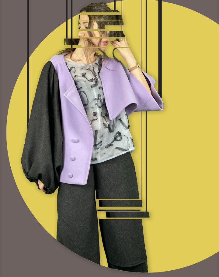 Asymmetric short purple jacket worn on its own.