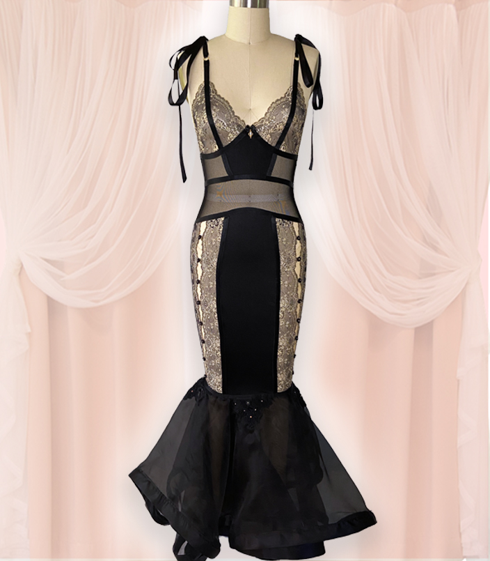 Inspired by the Madonna Inn located in California, vintage valentines, and the Victorian revival of the 1970s, this full-length control slip features two-toned lace, nylon spandex, power mesh, and silk organza. Details include silk ribbons, rosettes, Swarovski crystals, and lace appliqués where the skirt and slip meet.