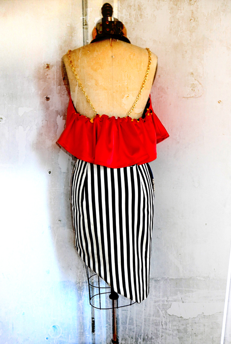 Back of red satin halter top and wrap skirt.
