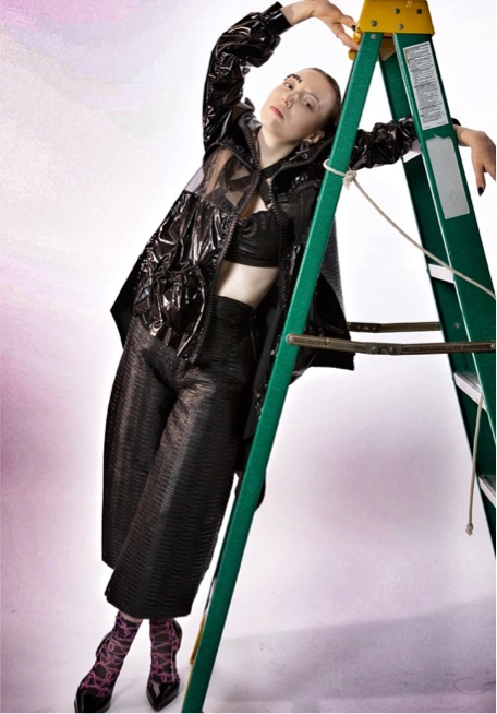 Jingwen Xuan Collection Photo 1 - Front view of garment. Model leaning against green ladder