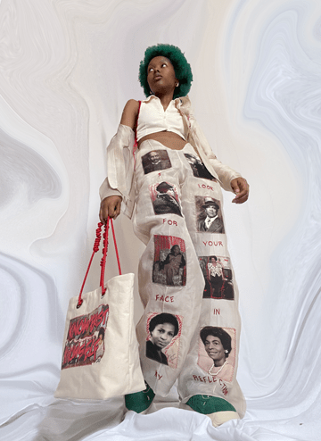 """Silk chiffon pant with family photos stitched/patched onto the front of the pant leg. In addition, hand embroidery that states """"I look for your face in my reflection."""""""