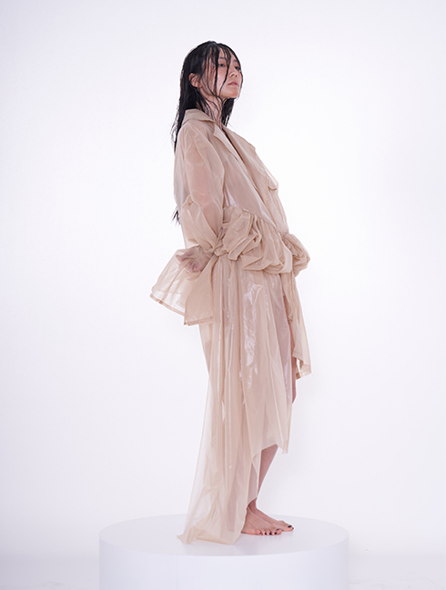 Extra volume of fabric.  Exaggerated silhouette. Translucent jacket.