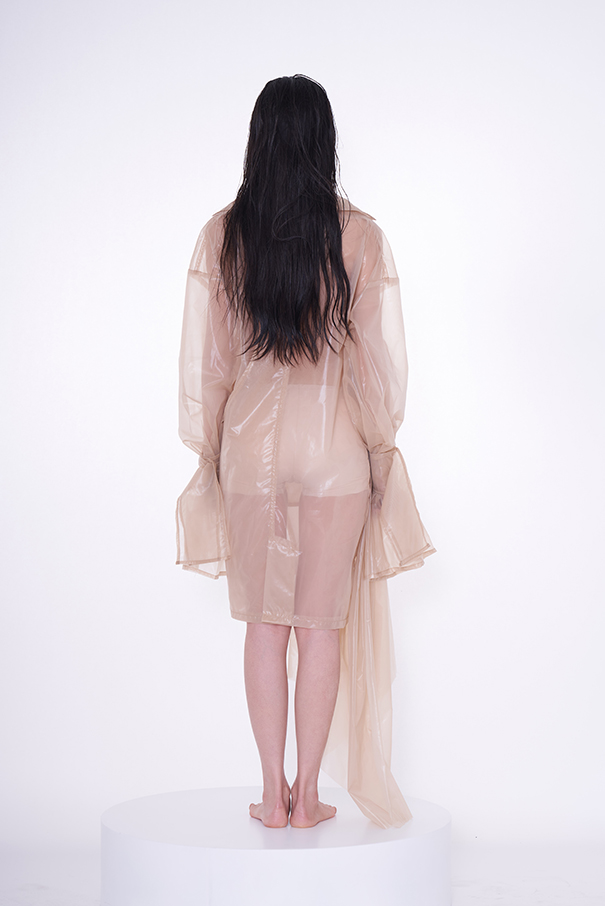 Back view of organza jacket with long sleeve.