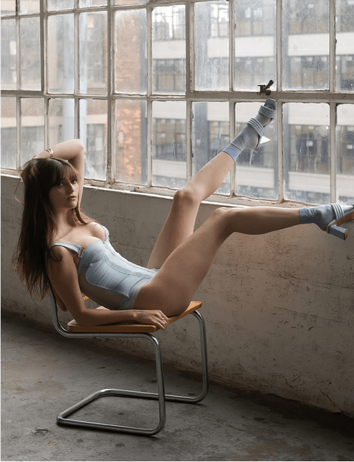 Lauren Starobin Collection Photo 2 - Model sitting on chair, with legs pointing up