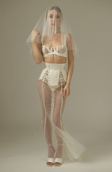 Front view of full look: lace bra and panty, duchess satin waist cincher, tulle veil and skirt