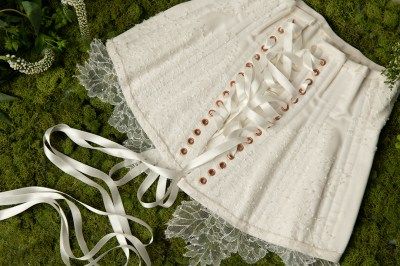 Detail of hand appliquéd lace and beading on waist cincher