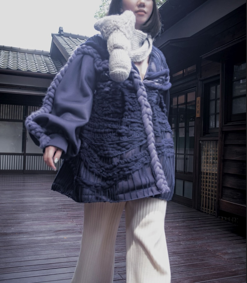 """""""A new mixed-culture aesthetic inspired by Japanese traditions. Navy drop-shoulder coat, with blouson sleeve, hand-woven detail overlay, and hand braided cable trim. Eco-Cotton ivory rib wide-leg pant, and handknit horse head scarf. Pictures all shot in Qidong Street Japanese Houses Photographer: Li, Po-Yi (Loca Lee)"""""""