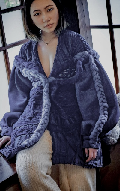 Grey handknit horse head scarf featuring mixture of wool and metallic yarn in Tatami Interior.