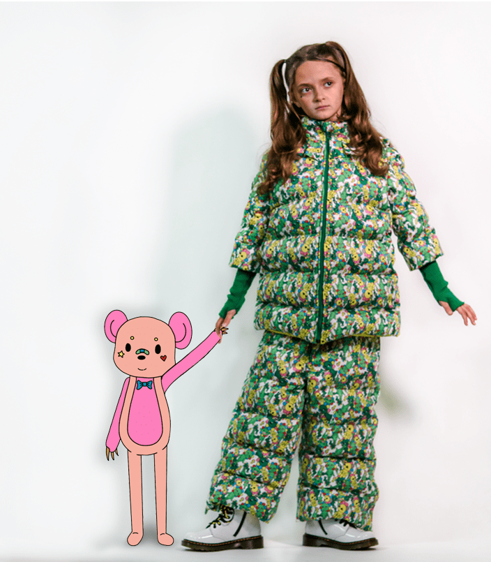 This collection was born from the idea that fashion should be an expression of one's creativity. Inspired by world renowned artist, Takashi Murakami, silhouettes and prints showcase the power of imagination. Featuring a custom printed quilted puffer zip up jacket with snap on puffer pants and knit fingerless glove cuffs.