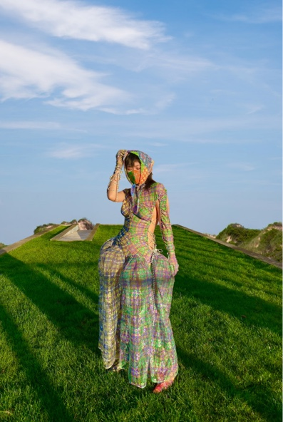 Esther Yitao Li Collection Photo 1 - Front view of garment. Green grass environment, blue sky in the background