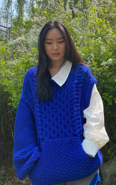 """""""The moss stitch kangaroo pocket adds more youthfulness to the sweater. It is knit separately from the sweater and later attached. """""""