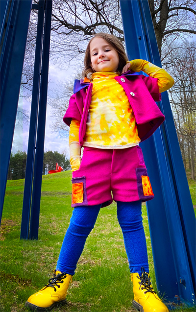 This angle features the fly front shorts with functional orange and purple patch pockets as well as additional lined front pockets in a contrast magenta silk shantung fabric.