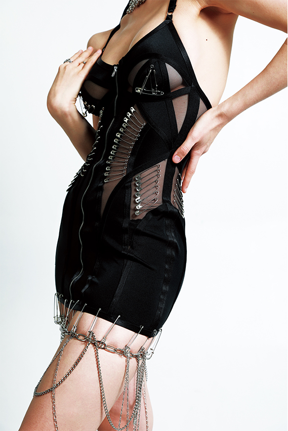 The usage of lycra and sheer illusion shows a black three dimensional feeling, wrapping up with silk elastic. Silver safety pins arrange on front and the side front.