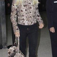 Donatella Versace into snakeskin!