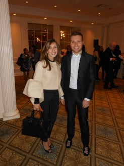 Andrea Abrams is wearing a Delpozo jacket, her pants are by St. Laurent, shoes are by Gucci. David Chines is wearing a Valentino suit, his shoes and shirt are by Gucci.
