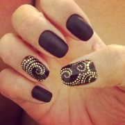amazing black and gold nail design