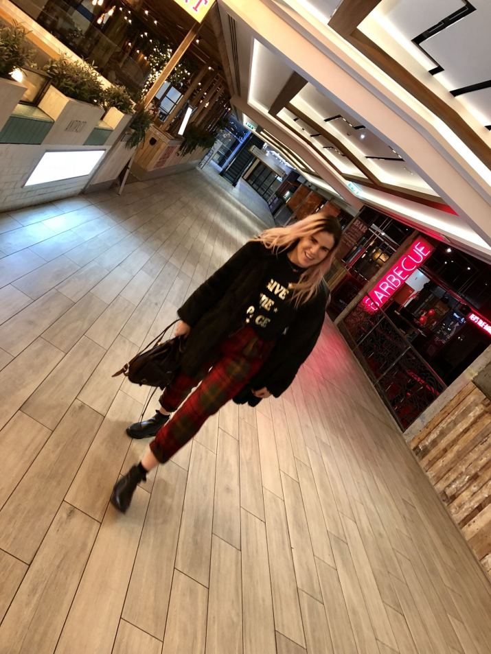 Blogger Pixie Tenenbaum wears vintage tartan pringle golf pants with a faux fur coat to Tapas Revolution at Intu Eldon Square Newcastle